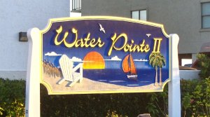 water pointe II sandblasted hdu sign gold leaf carved pine trees chair etc classic signs nc