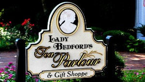 lady bedford hand carved bas relief with 23kt gold prismatic letters on sandblasted sign by classic signs nc 300x169