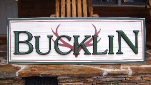 bucklin sandblasted hdu community sign with woodgrain and applique prismatic