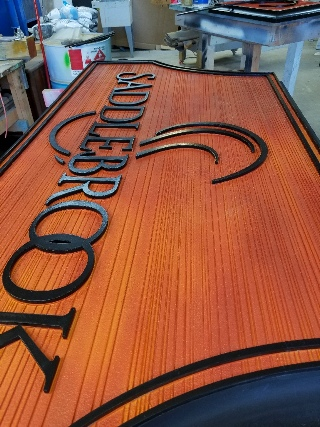 saddlebrook 3in deep sandblasted HDU sign with woodgrain effect 2 by signblasters com 320x240