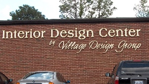village design custom cut hdu sandblasted letters gold leaf classic signs nc 300x169
